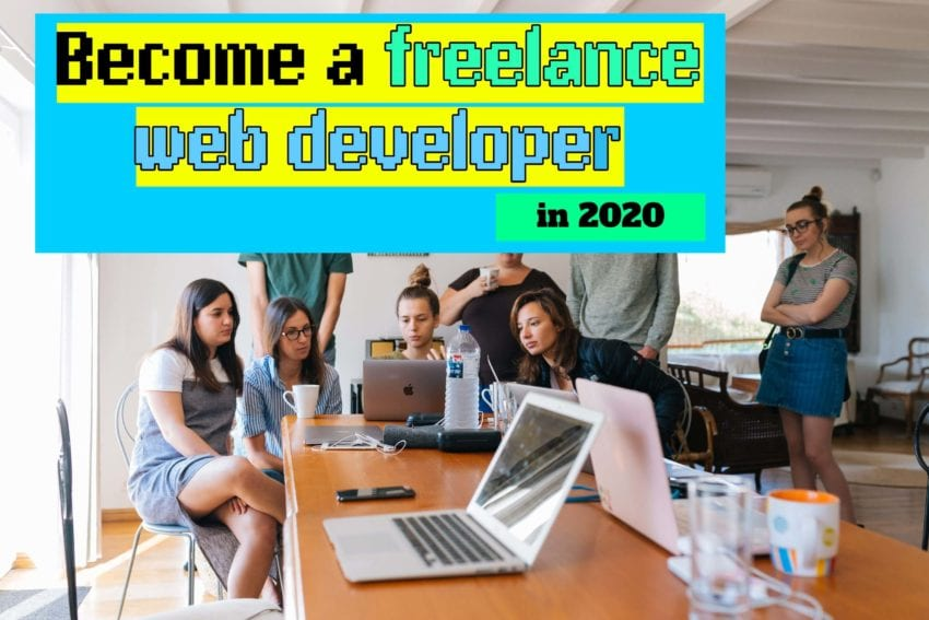 Group of people behind laptop training to become a freelance web developer