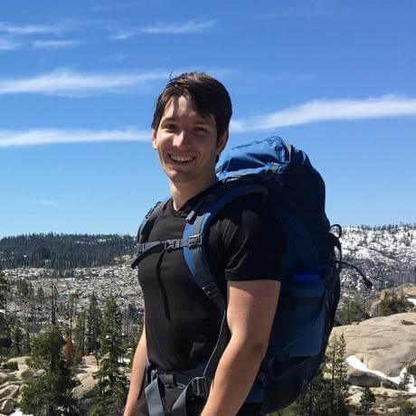 Antoine Pourchet co-founder of algoexpert standing with backpack and mountains
