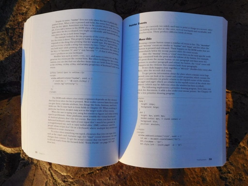 Eloquent JavaScript book open to Handling Events chapter