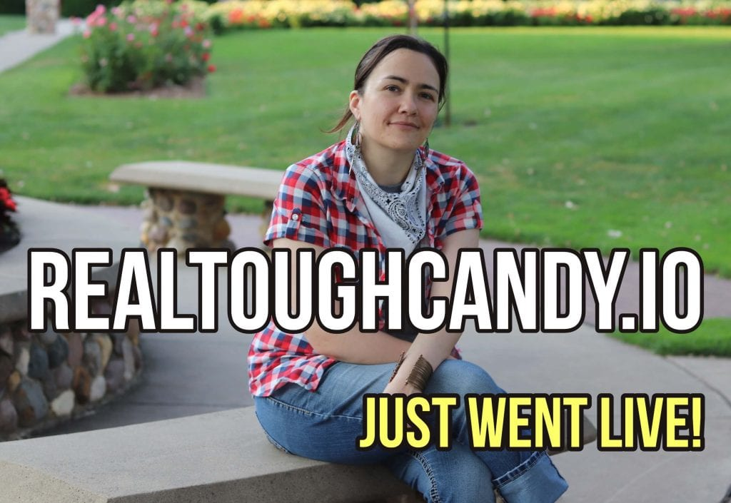 Woman instructor RTC sitting on park bench with RealToughCandy Just Went Live! in white and yellow
